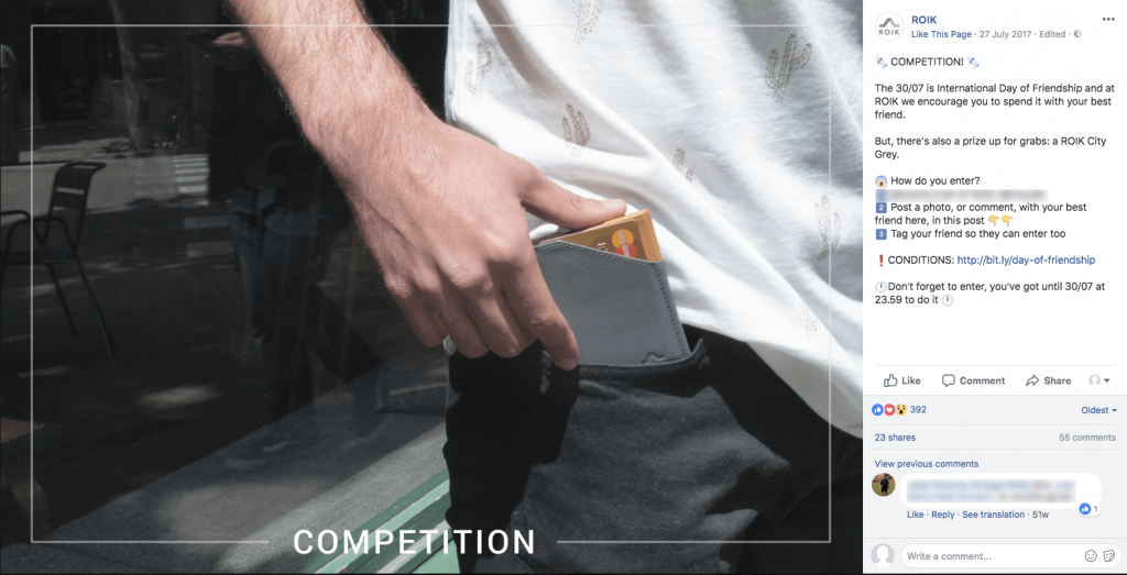 Screenshot of a Facebook photo contest for Friendship Day. The main image shows someone reaching into their pocket to pull out a wallet. The caption invites people to share a photo with their best friend for the chance to win the featured wallet.