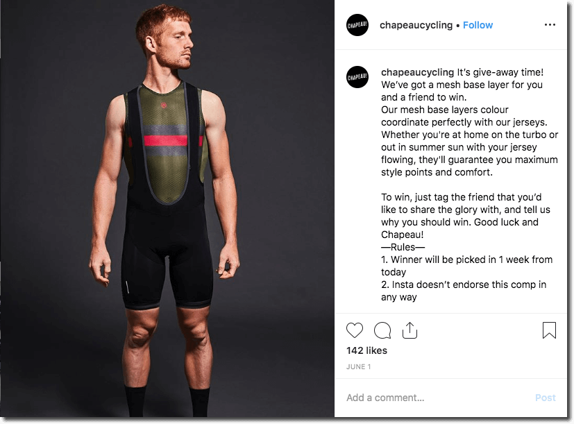 Screenshot of an Instagram giveaway for cycling clothes. The main image shows a young, red-haired man wearing a mesh base layer. The caption describes the product in detail and asks people to comment and tag friends for a chance to win.