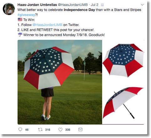 Screenshot of an Independence Day giveaway on Twitter. The image shows a young woman walking across a golf course, with her back to the camera. She is carrying a stars and stripes umbrella. Inset images show the umbrella in more detail. The caption invites users to follow, like, and retweet the post for the chance to win an umbrella.