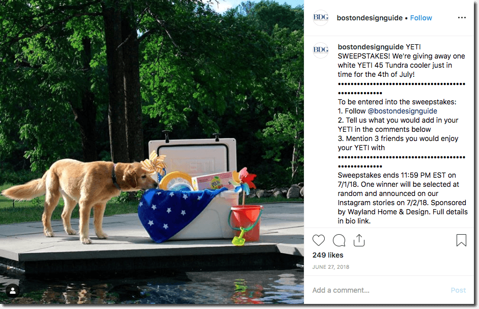 Screenshot of an Independence Day giveaway on Instagram. The image shows a golden retriever beside a swimming pool, next to a Yeti coolbox filled with toys and United States flags. The caption invites users to comment what they would put in the Yeti for the chance to win it on the 4th of July.