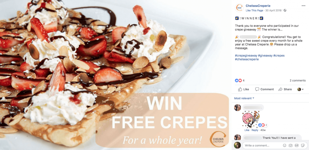 "A Pancake Day giveaway post on Facebook. The image shows crepes with strawberries, cream and chocolate, with the title ""Win free crepes for a whole year!"". The caption announces the winner of the giveaway."