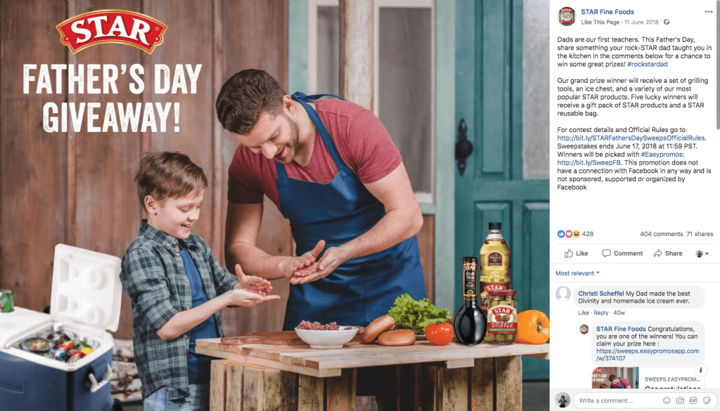 "Example of Father's Day giveaways on Facebook. The image shows a father and son in the kitchen together, cooking with ingredients including Star products. The text overlay reads, ""Star Father's day giveaway!"""