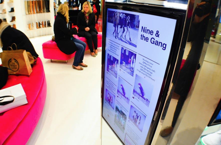 Photo of a display screen in store, showing Instagram photos from customers.