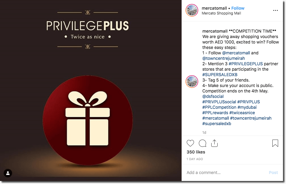 "This Instagram post simply shows a stylized cartoon of a gift box, set against a red circle. Above the design, a title reads: ""Privilege Plus: twice as nice."" The caption invites users to enter a prize draw for shopping vouchers, by commenting on the post with a list of stores participating in the scheme."