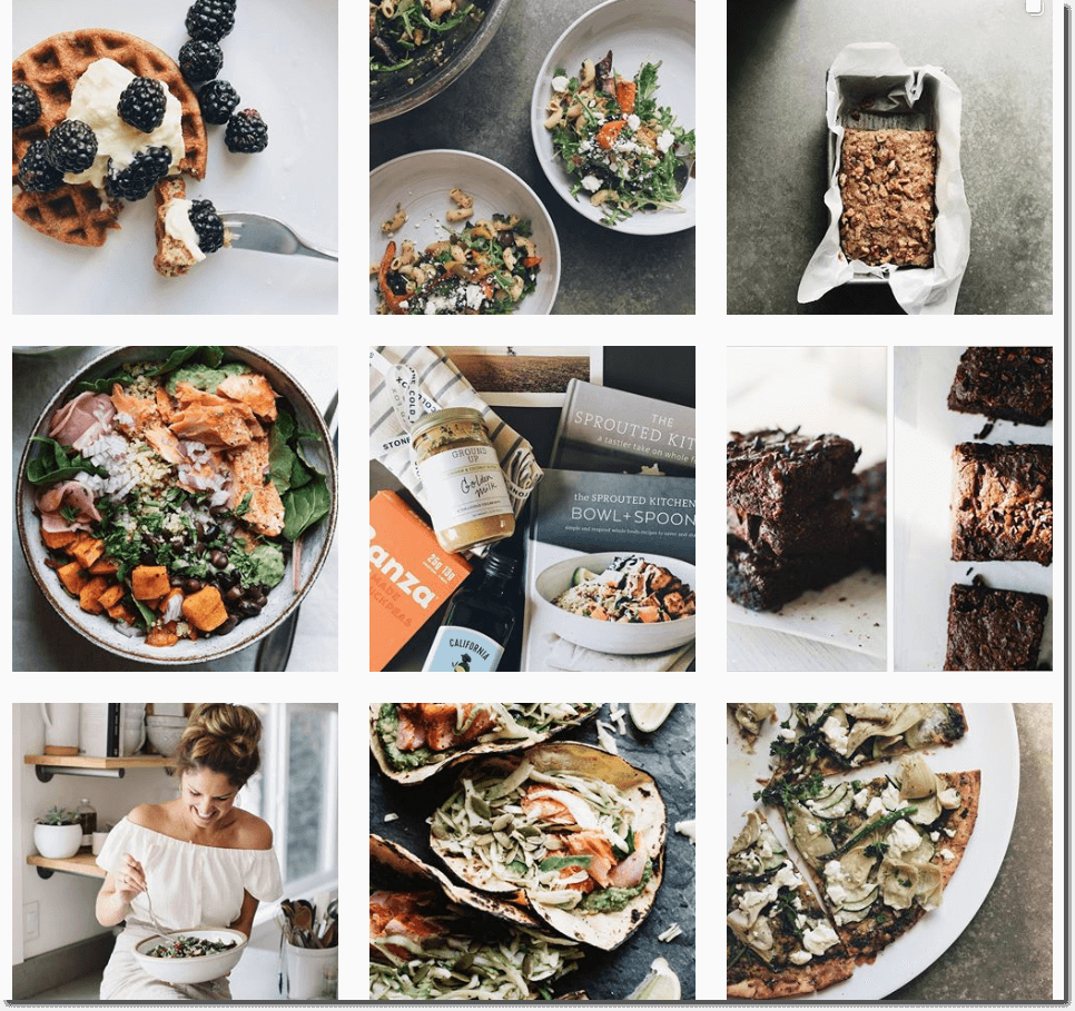 Screenshot of the Sprouted Kitchen Instagram feed. All the images are in cool tones with deep browns and blacks (for example, photos of blackberries or brownies).