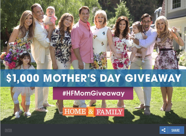 "Banner announcing a Mother's Day video contest. The photo shows a large family posing for a photo in a garden. The text reads: ""$1000 Mother's Day giveaway. #HFMomGiveaway Home & Family""."
